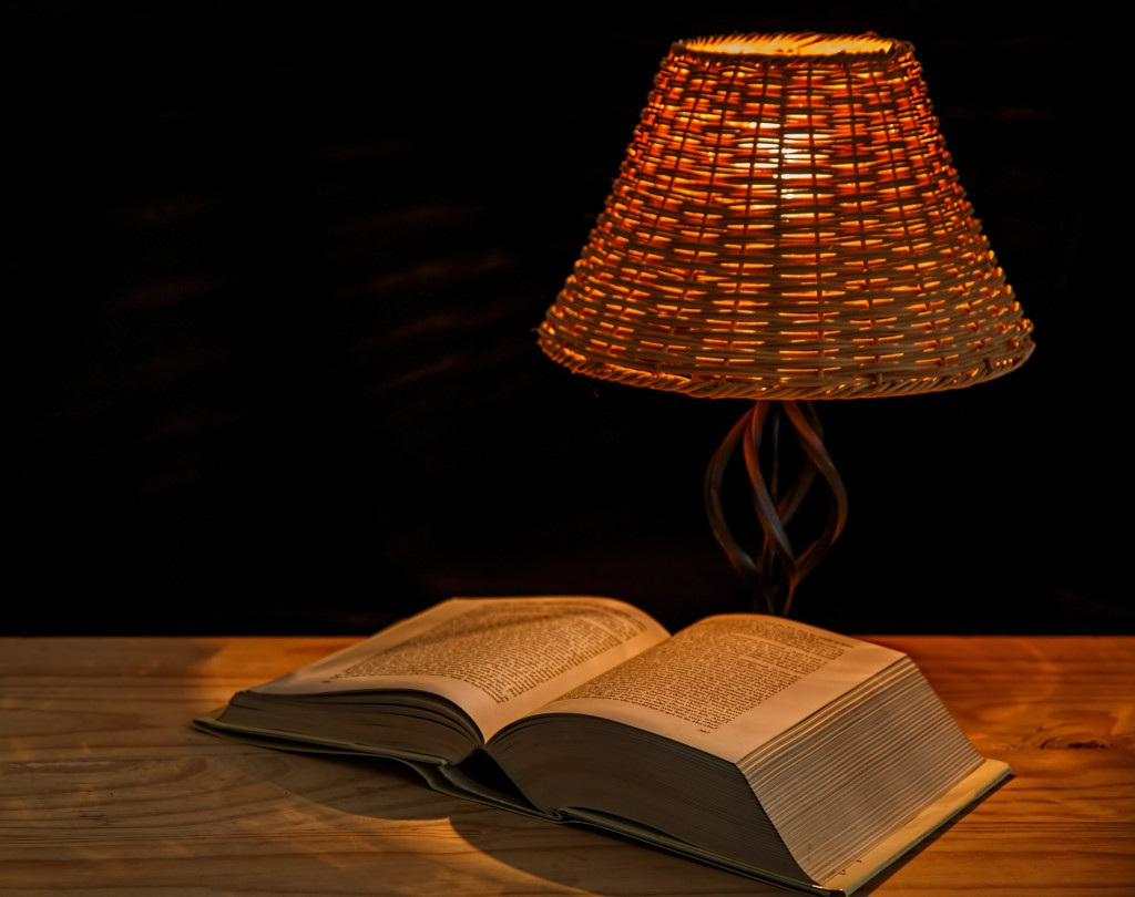 old book with lamp