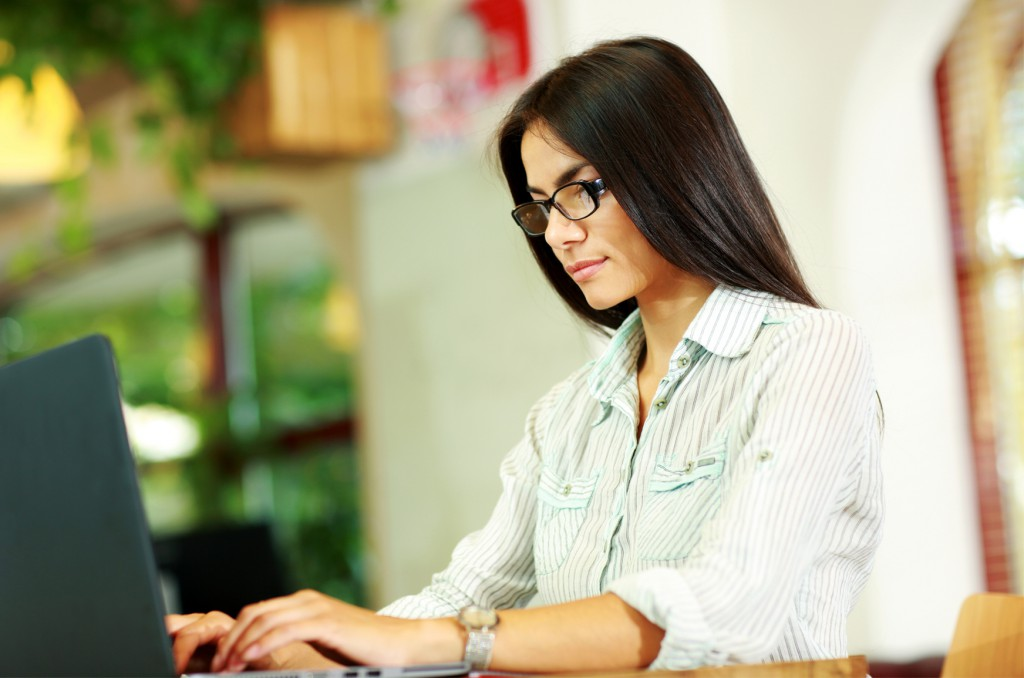 beautiful woman typing on computer content