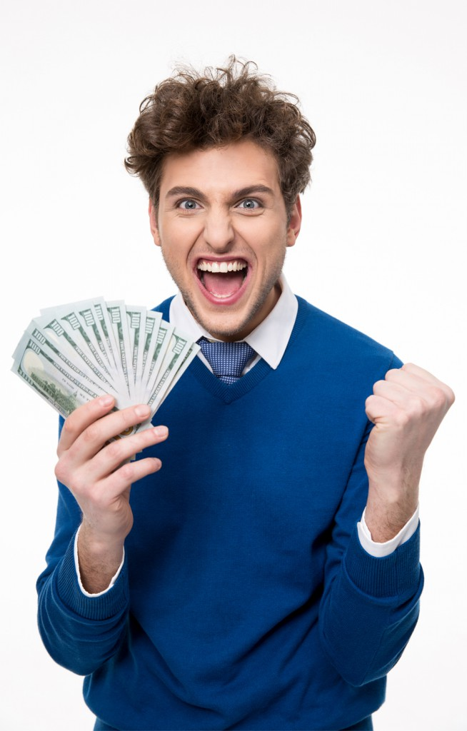 happy man made and holding money