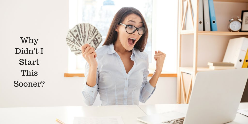 Young Woman Holding Money after blogging